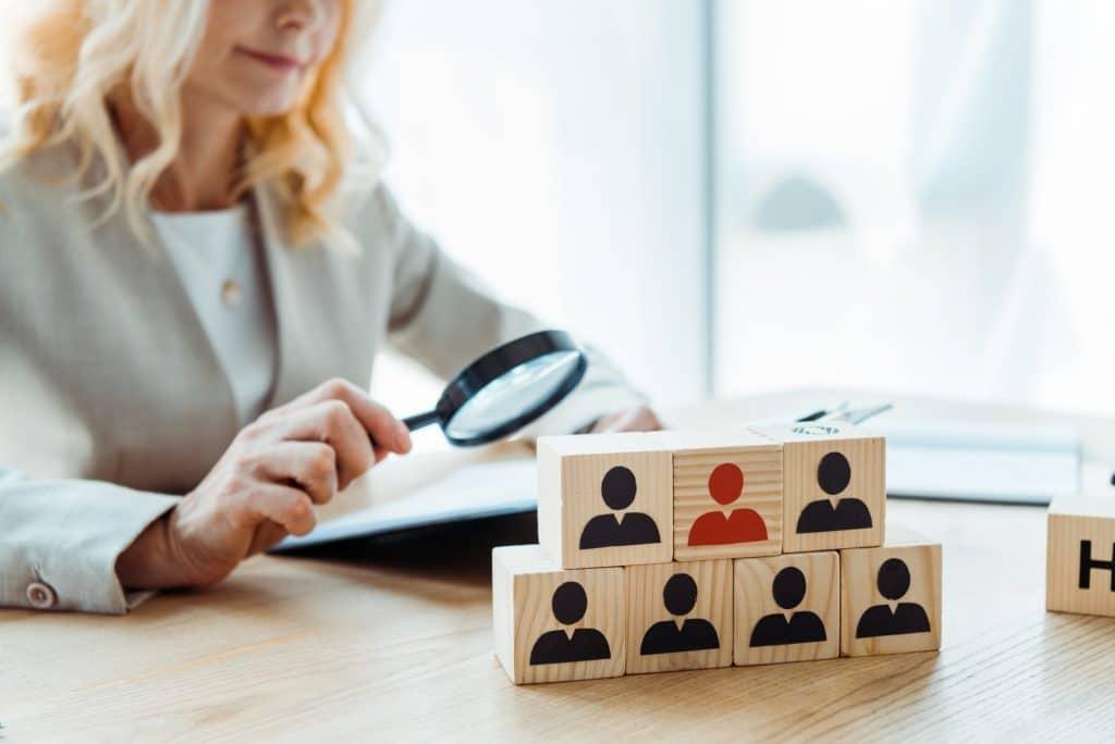 selective focus of wooden cubes near blonde recruiter